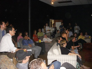 Nearly 60 people gathered July 30 in the black box at Story Slam! to hear about the project.